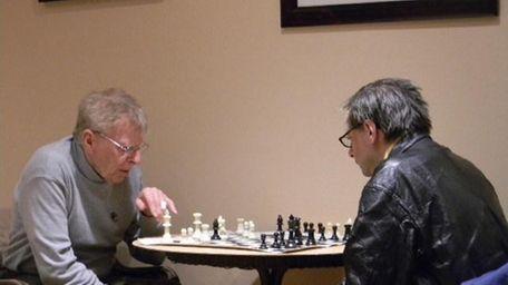 Charlie Evrard (left) squares off against Henry Despres