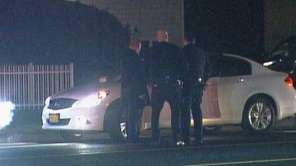 Police conduct an investigation on Oakwood Road at
