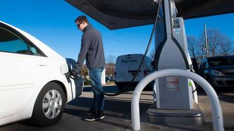 Blake McCarthy of Glen Cove pumps gas at