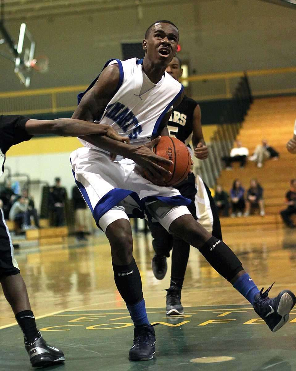 St. Mary's Chavaughn Lewis gets held during the