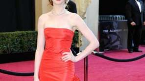 Actress and Oscar cohost Anne Hathaway arrives in