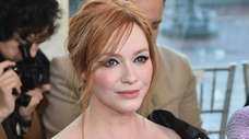 Christina Hendricks sits in the front row at