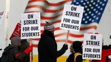 Teachers walk a picket line outside South High