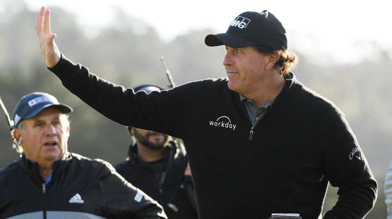 Phil Mickelson celebrates winning on the 18th green