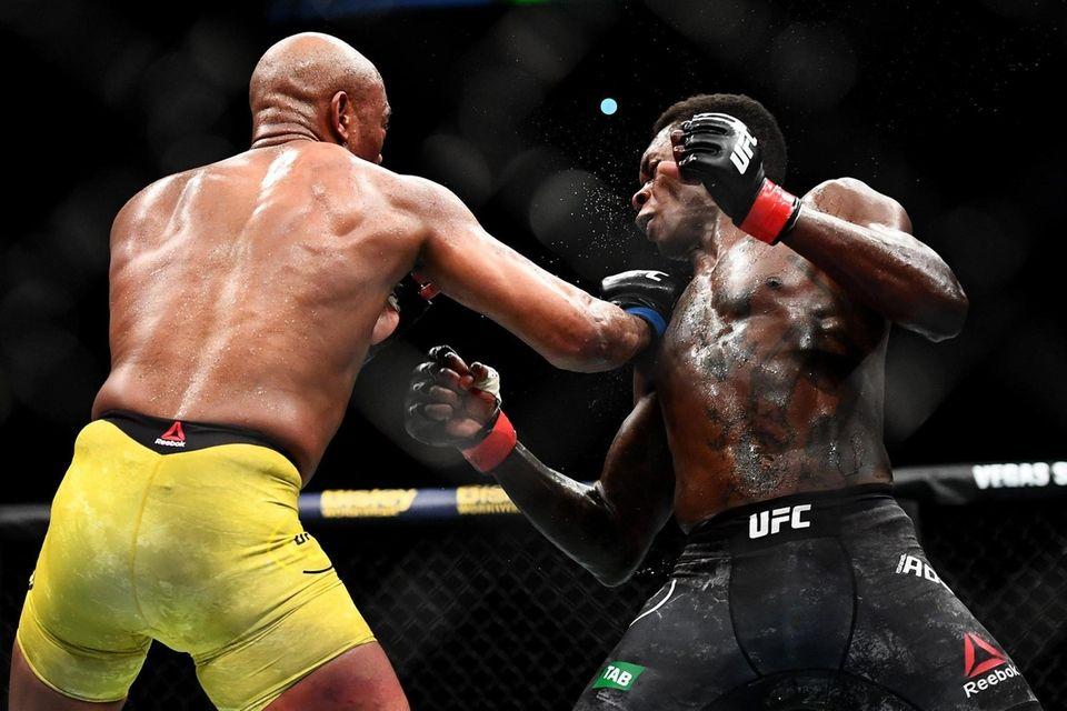 Anderson Silva of Brazil punches Israel Adesanya of