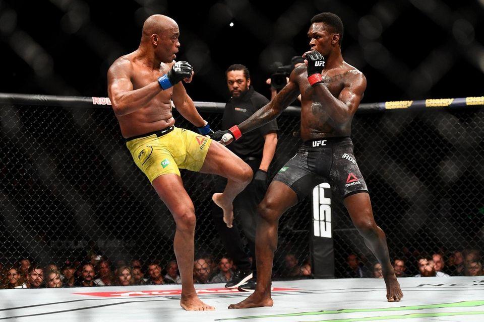 Anderson Silva of Brazil kicks Israel Adesanya of