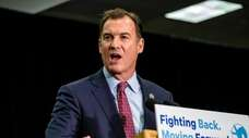 Tom Suozzi speaks during a get out the