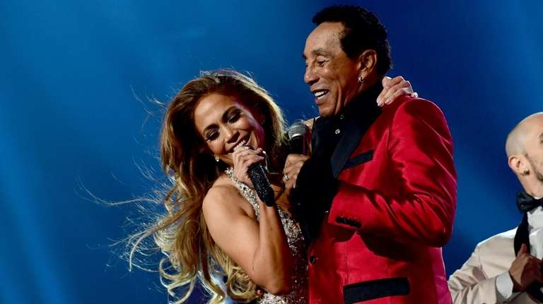 Jennifer Lopez and Smokey Robinson perform onstage during