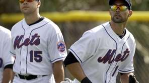 New York Mets' Angel Pagan, right, tracks down