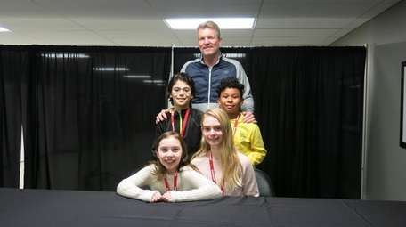 Jim Courier with Kidsday reporters, clockwise from middle