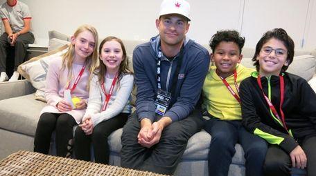 Kidsday reporters Ella Jacobs, left, Phoebe Falk, Daniel