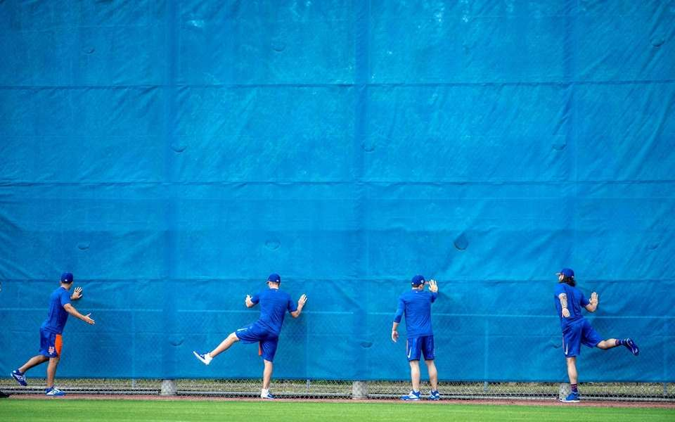 New York Mets players warm up during a