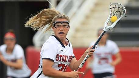 Stony Brook's Ally Kennedy #30 flys up the