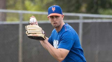 Mets utility man Jeff McNeil throws during a