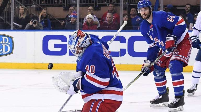 Rangers goaltender Alexandar Georgiev makes one of his
