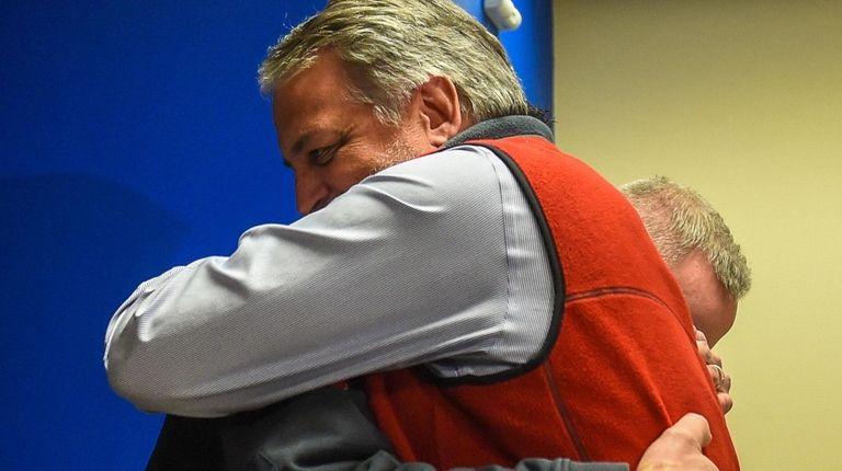 Greg Antolini hugs Marine Bureau Lt. Edward Mulroy