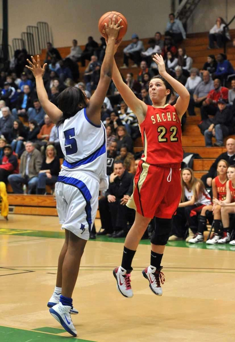 Sachem East's Meagan Doherty shoots over North Babylon's