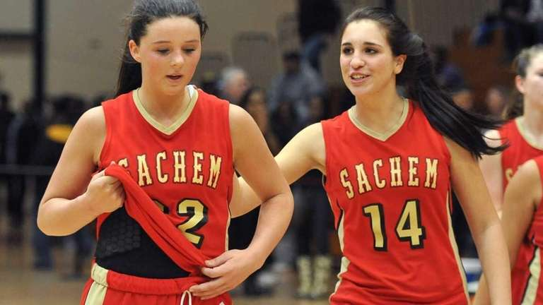Sachem East's Meagan Doherty (22) is congratulated by