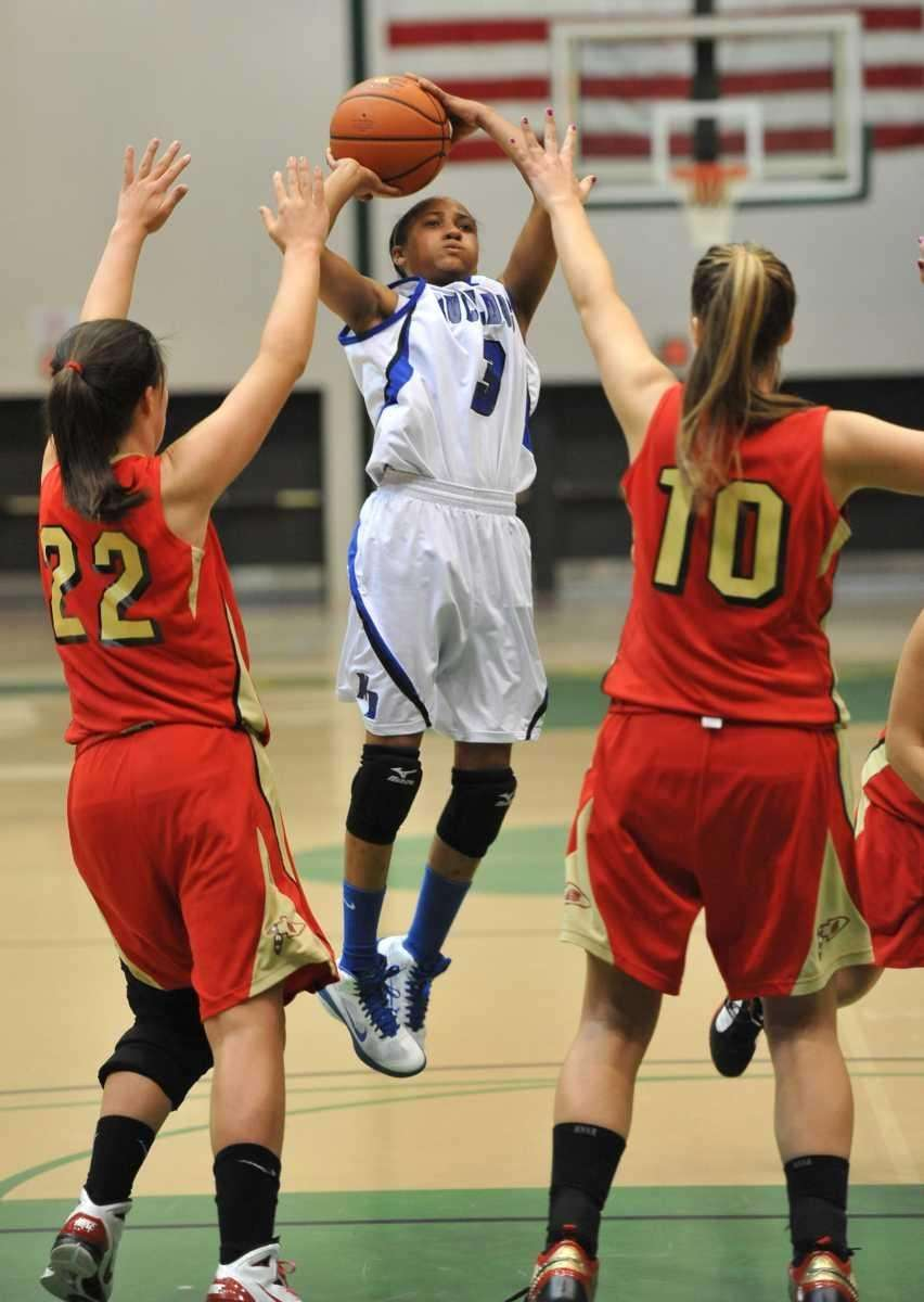 North Babylon's Charise Wilson (3) shoots over Sachem
