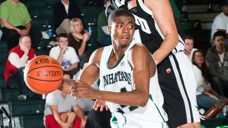 Manhattan sophomore guard George Beamon drives to the