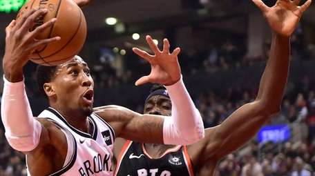 Brooklyn Nets forward Rondae Hollis-Jefferson (24) drives for