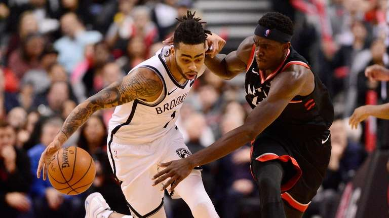 Nets guard D'Angelo Russell, left, and Toronto Raptors