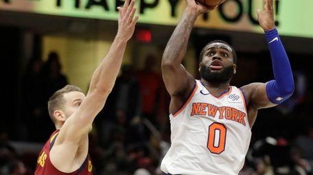 New York Knicks' Kadeem Allen (0) shoots over