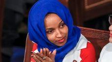 Rep. Ilhan Omar (D-Minn.), listens to President Donald