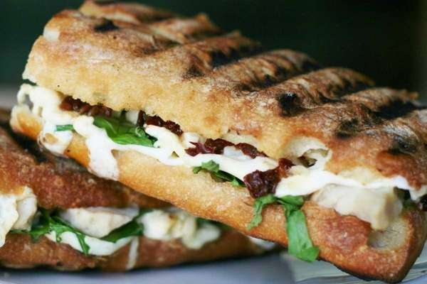 Chicken, mozzarella, sun dried tomato and arugula panini.