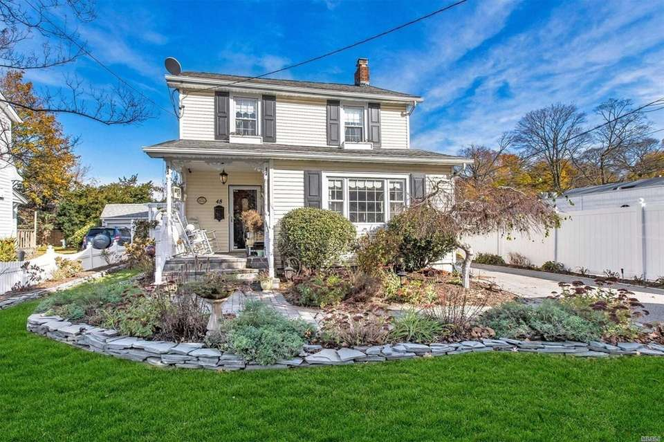 This Amityville Colonial includes three bedrooms and 1