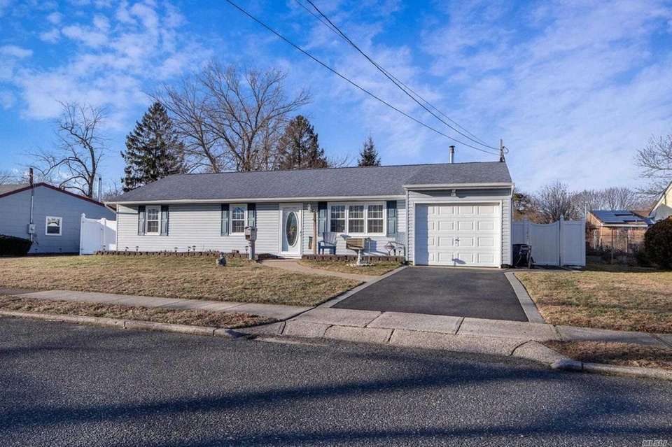 This Central Islip ranch features three bedrooms and