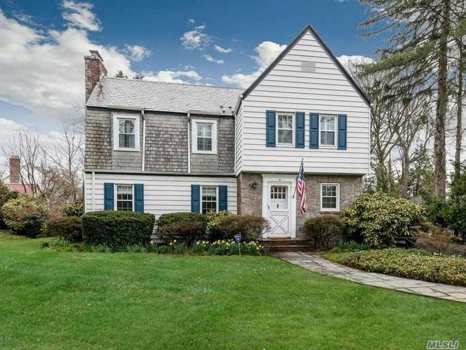 This Roslyn Colonial includes three bedrooms and 2