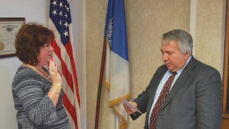 Peggy Fraser, left, is sworn in as Long