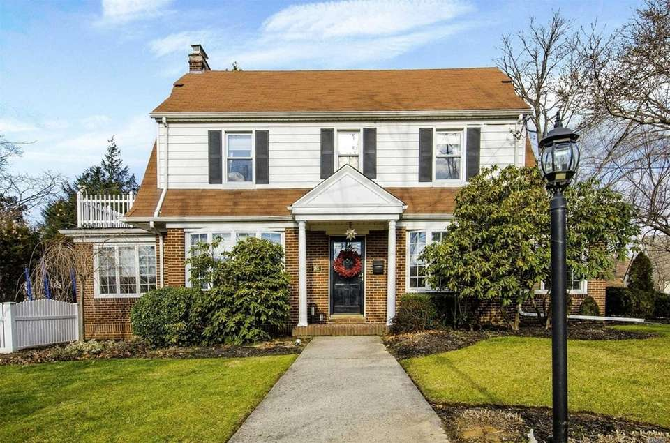 This Manhasset Colonial includes three bedrooms and 2