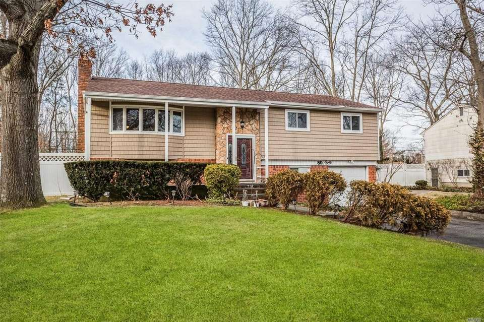 This Smithtown high-ranch includes four bedrooms and two