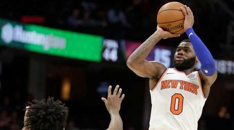 The Knicks' Kadeem Allen shoots over Cleveland's Collin