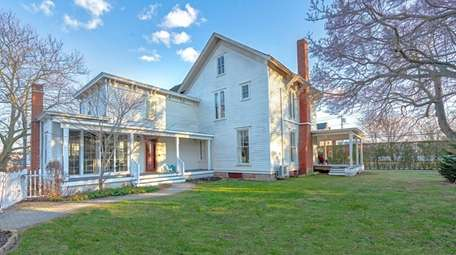 This Greenport home has two renovated kitchens and