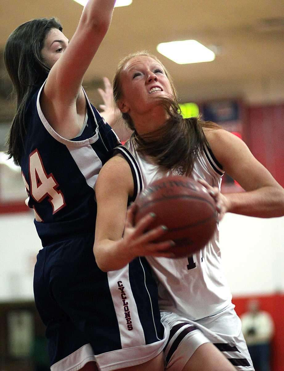 Garden City's Barbara Sullivan takes a layup during