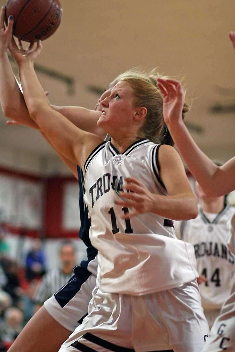 Garden City's Barbara Sullivan goes for the ball