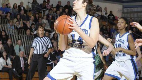 Allison McKenna of Glenn grabs a rebound against