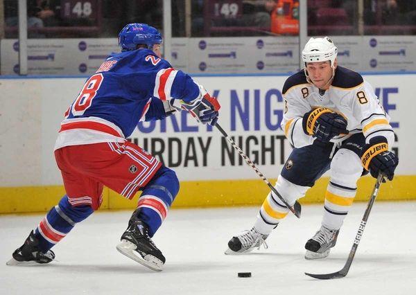 Buffalo Sabres center Cody McCormick (8) controls the