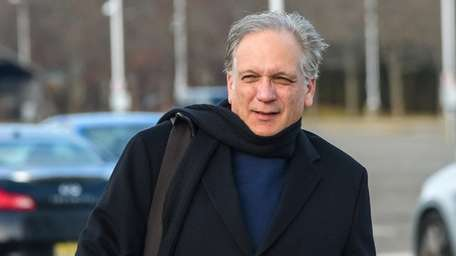 Edward Mangano arrives at federal court in Central