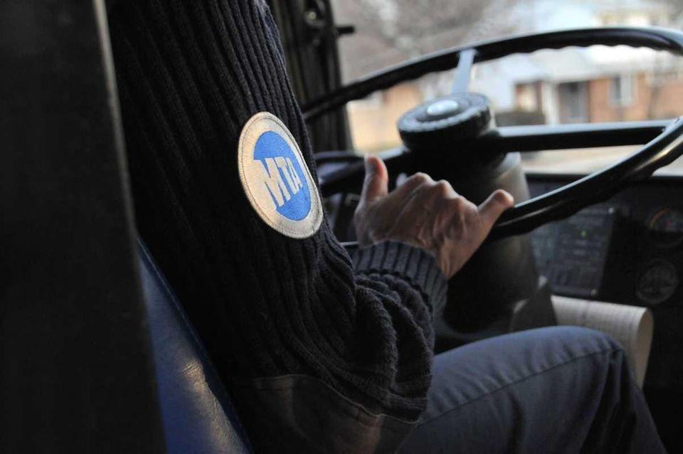 An MTA driver operates a bus on LI.