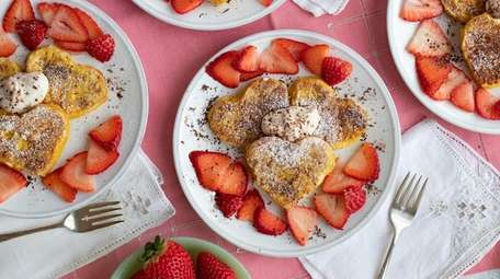 French toast with strawberries, chocolate shavings and a