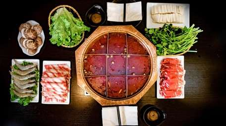 The hot pot with rolled beef and lamb,