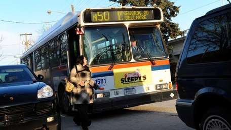 A passenger exits the N50 bus, one that
