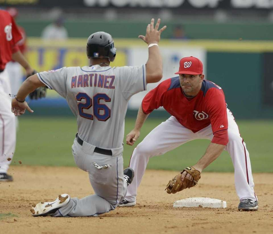 New York Mets' Fernando Martinez (26) is tagged