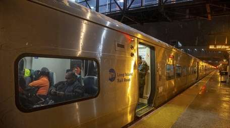 Commuters dodge snowflake at the LIRR station on