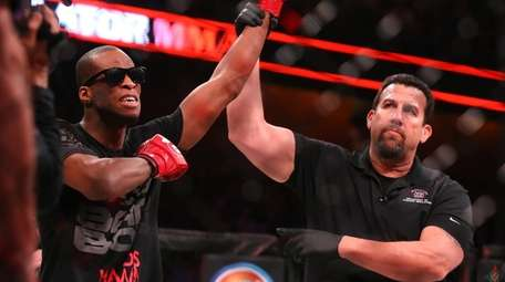Michael Page celebrates his first-round submission win over