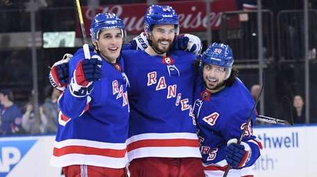 Rangers defenseman Adam McQuaid, center, celebrates his goal